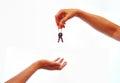 Hand giving away house keys Royalty Free Stock Photo
