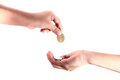 Hand giving a coin to another person cropped view of Royalty Free Stock Images