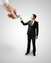 Hand giving dollars to businessman Royalty Free Stock Photography