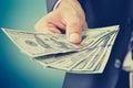 Hand giving money, US dollar (USD) bills Royalty Free Stock Photo