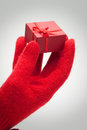 Hand giving red box with present Stock Images