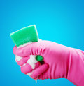 Hand gloves and a sponge with foam Stock Image