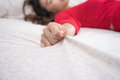 Hand grasp bed sheet red shirt Stock Photography