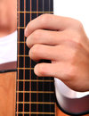 Hand and guitar closeup play the chord on acoustic Royalty Free Stock Image