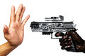 Hand with gun stained with engine oil pointing to empty hand Royalty Free Stock Photography