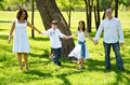 Hand in hand family that is american venezuelan mixed holding hands and walking thru he park Stock Photo