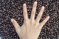 The hand Hand five finger sign and coffee beans Royalty Free Stock Photo