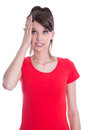 Hand at head young woman in red is anxious portrait of isolated teenager with has problems Royalty Free Stock Photos