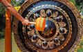 Hand hit gong big in temple Royalty Free Stock Image