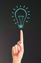 Hand hold bright light bulb with chalk board Royalty Free Stock Photo