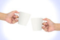 Hand hold cup clink glasses a of coffee isolated on the white background Stock Photo