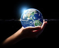 Hand hold earth in universe environment element fini Royalty Free Stock Photo