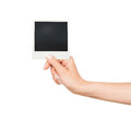 Hand holding blank Instant Photo on white background Royalty Free Stock Photo