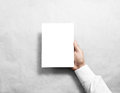 Hand holding blank white brochure booklet Royalty Free Stock Photo