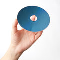 Hand holding blu-ray disk Royalty Free Stock Photo