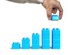 Hand holding blue block complete growth bar graph shape Royalty Free Stock Photo