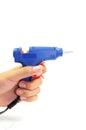 Hand holding blue glue gun Stock Photos