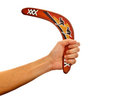 Hand holding a boomerang Royalty Free Stock Photo