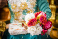 Hand holding bouquet of flower a bride s a on wedding day Stock Photos