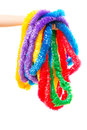 Hand Holding a bunch of party leis Royalty Free Stock Photo