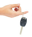 Hand holding a car key isolated on white background Stock Images