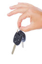 Hand holding a car keys isolated on white background Royalty Free Stock Photos