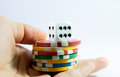 Hand holding casino chips and dice seven a white Royalty Free Stock Photos