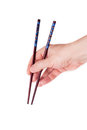 Hand holding chopsticks on a white background Royalty Free Stock Image