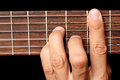 Hand holding a chord, and vibrating strings Royalty Free Stock Photo