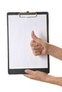 Hand holding clipboard with blank sheet of paper Stock Images