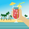 Hand holding cocktail with icecubes, straw and umbrella over tropical beach