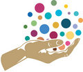 Hand holding colorful balls Royalty Free Stock Photo