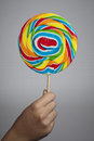 Hand holding colorful lollipop candy young child Royalty Free Stock Photo