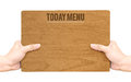 Hand holding dark brown wood signboard with Today Menu word isol