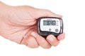Hand holding digital pedometer close up of on white background Stock Photo