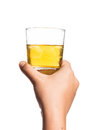 Hand holding a diluted glass of whiskey on the rocks Royalty Free Stock Photo