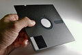 Hand holding Diskette of 5,25 inches Stock Photo