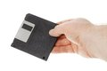Hand holding diskette one human a black inch manetic isolated on white Stock Photo