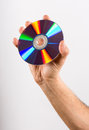 Hand Holding DVD CD Disc Against White Background Royalty Free Stock Photo