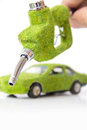Hand holding eco fuel nozzle Stock Image