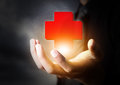 Hand holding first aid icon insurance concept Royalty Free Stock Photography
