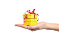 Hand holding gift box isolated female red and yellow with a bow on white Royalty Free Stock Photo