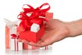 Hand holding a gift lot of boxes and woman s isolated on white Royalty Free Stock Image