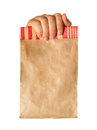 Hand holding or giving a brown paper bag Stock Photos