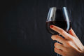 Hand holding glass of red wine Royalty Free Stock Photo