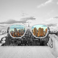 Hand holding glasses looking to modern skyscraper Royalty Free Stock Photos