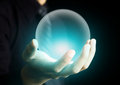 Hand holding a glowing crystal ball Royalty Free Stock Photo