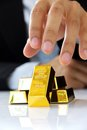 Hand holding gold bars Royalty Free Stock Photos