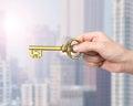 Hand holding golden treasure key in Euro symbol shape Royalty Free Stock Photo
