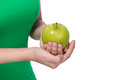 Hand holding green apple isolated over white background. Royalty Free Stock Photo